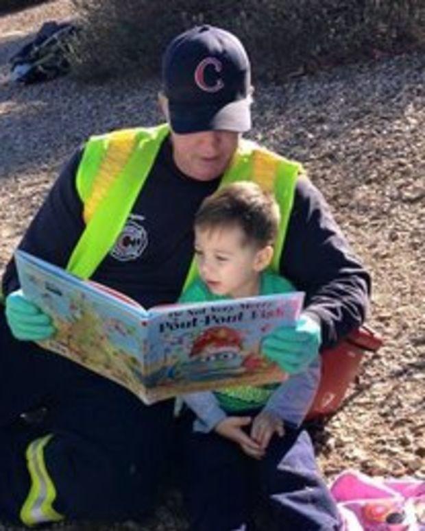 Firefighter Comforts Boy.