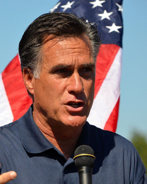 Mitt Romney Speaking In Front Of Flag