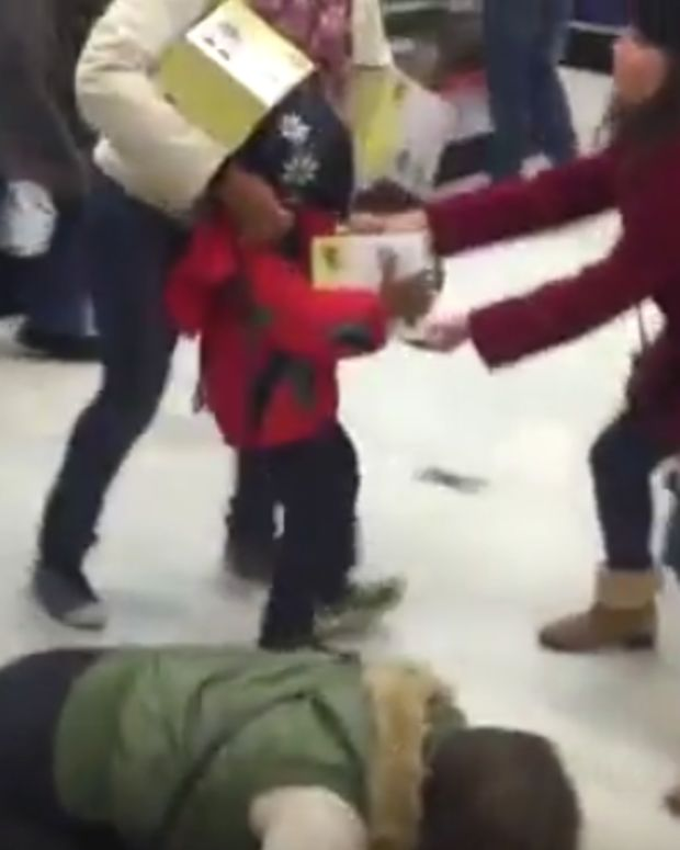 Black Friday Fight Woman Child
