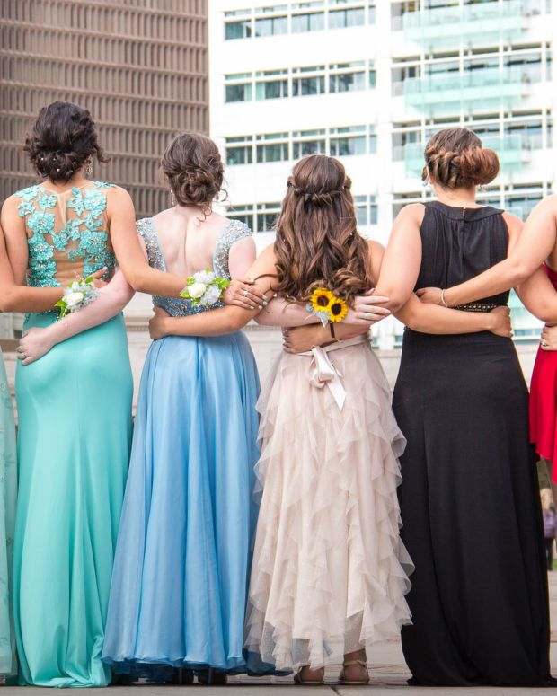Teens in prom dresses