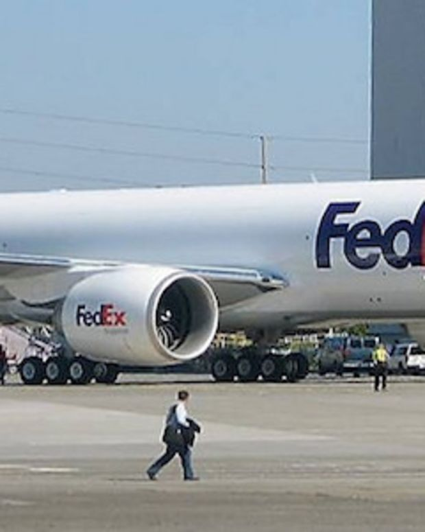 FedEx Worker Falls Asleep, Stows Away With Shipment  Promo Image