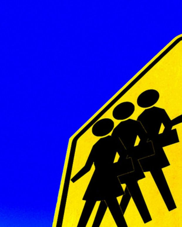 pedestrian crossing sign featuring one man with three women