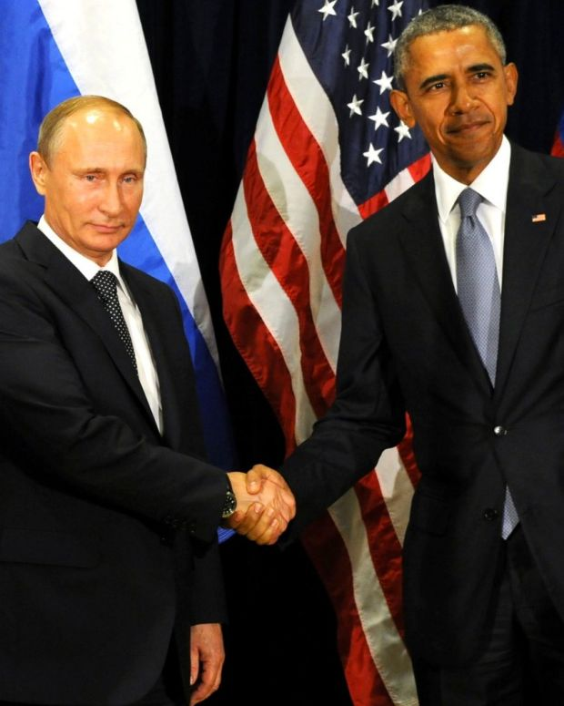 Obama, right, and Putin, left, shake hands in 2015