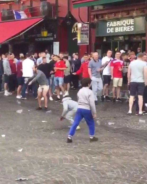 British Soccer Fans Toss Coins At Poor Kids (Video) Promo Image