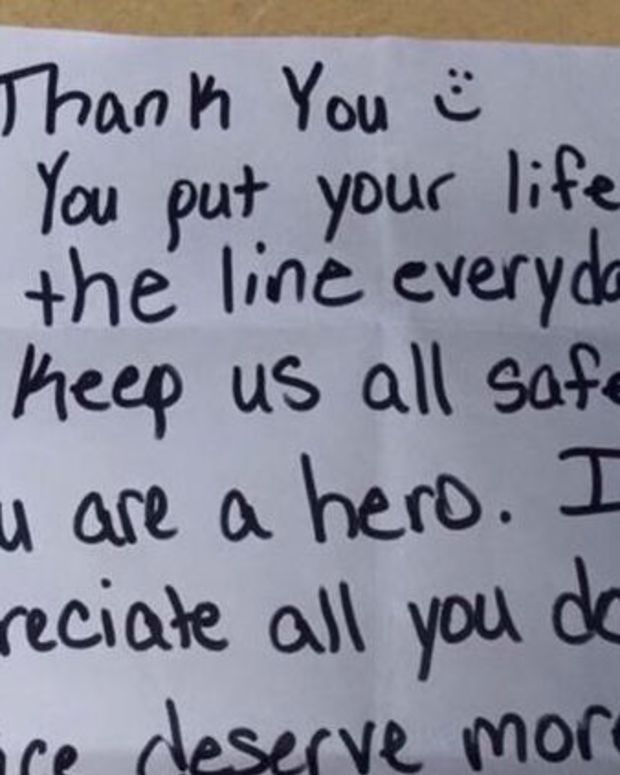 Photograph of note left on patrol car.