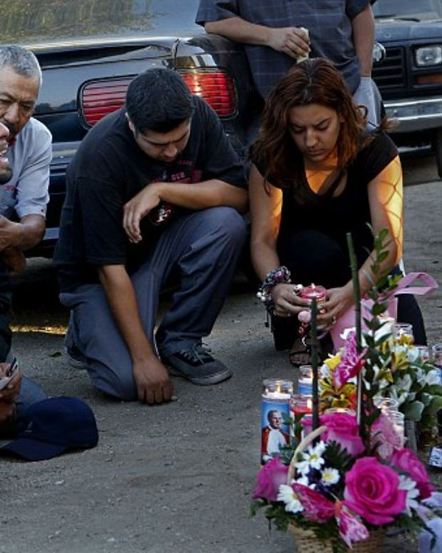 Distraught father of the three murdered girls, Rudy Coronado, at a vigil