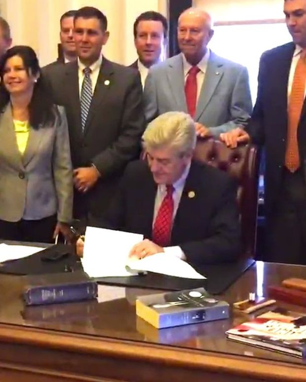 Mississippi Gov. Signs Guns In Churches Bill (Video) Promo Image