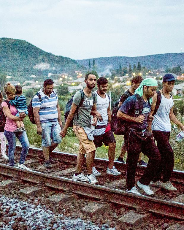 Syrian refugees on train tracks