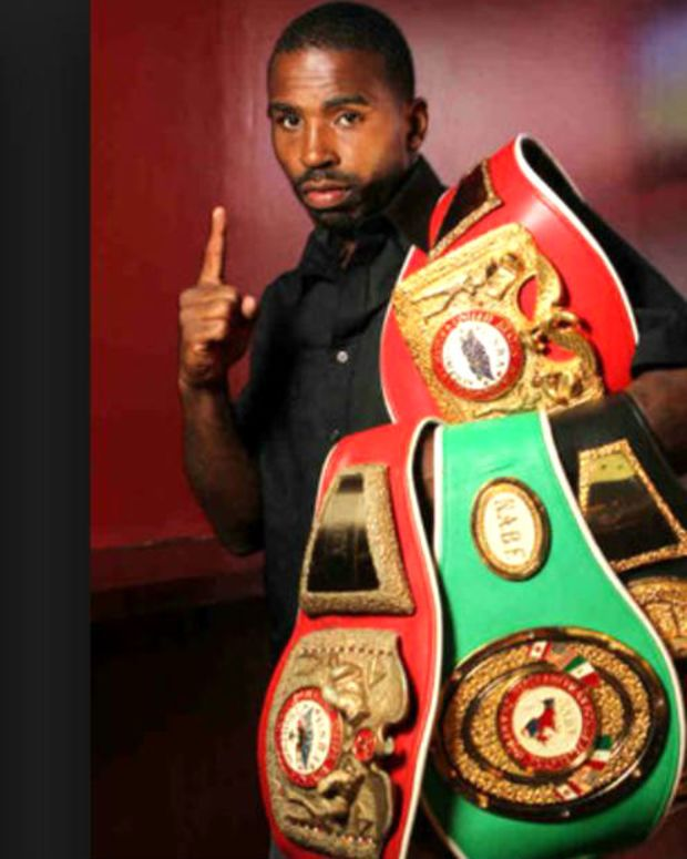 Yusaf Mack holding his title belts