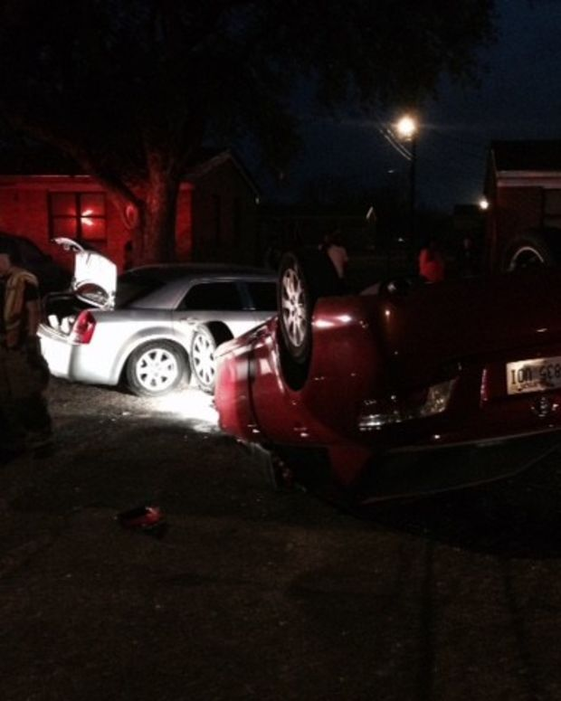 Aftermath of the wreckage, red car flipped over