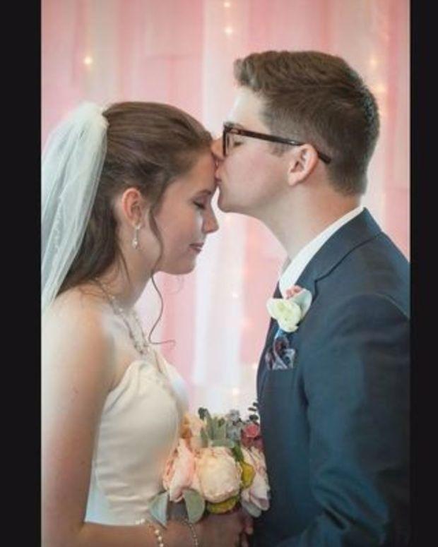 Dan and Kayla Amos on their wedding day