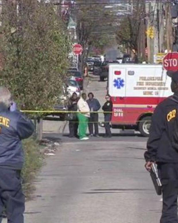 Investigators standing near crime scene where two dead babies were found in Philadelphia