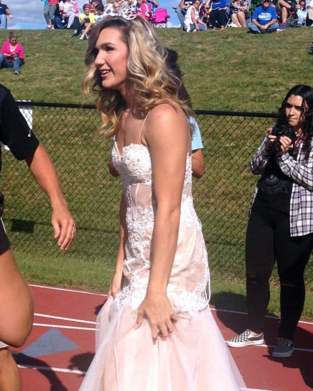 Patterson on field with homecoming queen crown