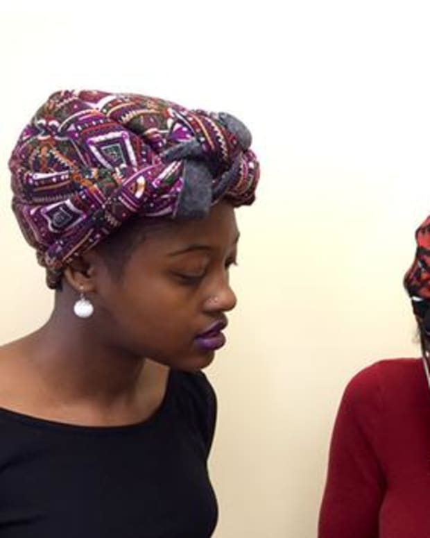 Students wearing geles, African head wraps
