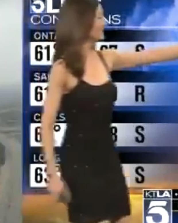 TV Anchor Covers Up Meteorologist's Dress (Video) Promo Image