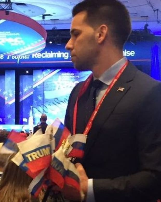 CPAC Attendees Wave Russian Flags During Trump's Speech (Photos) Promo Image