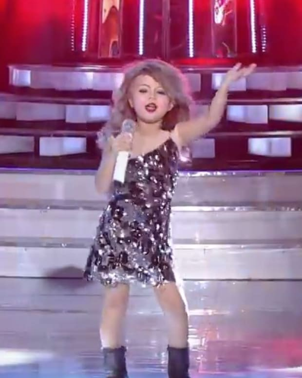 7-Year-Old Girl Performs Perfect Taylor Swift Impression (Video) Promo Image