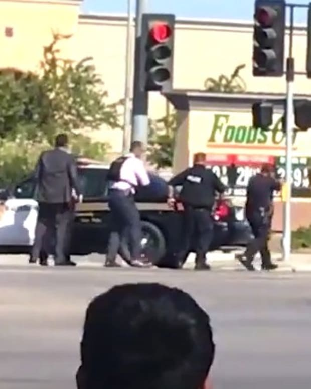 Cops Kill Man Running Away, Say He Charged (Video) Promo Image