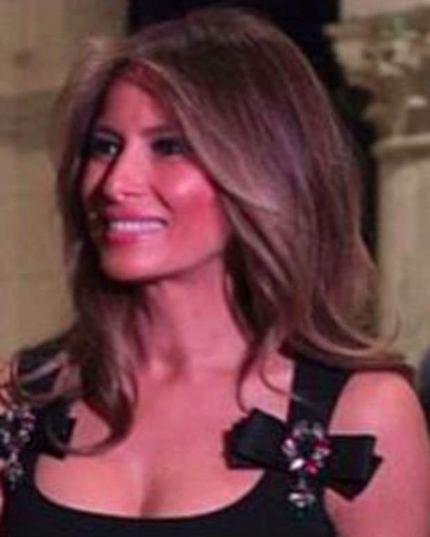 Melania Trump Dress Sparks Controversy (Photo) Promo Image