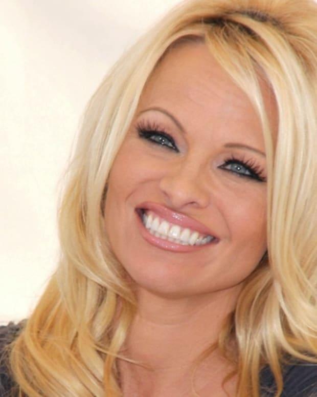 Pamela Anderson Defends Julian Assange (Video) Promo Image