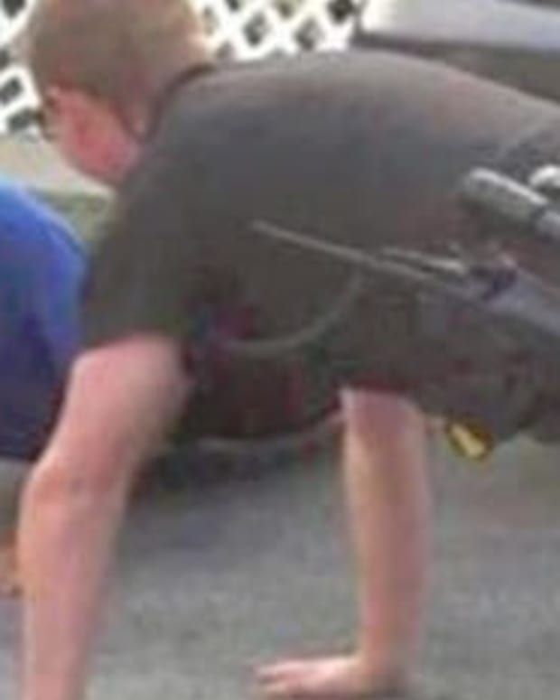Officer Does Pushups With Autistic Boy (Photo) Promo Image