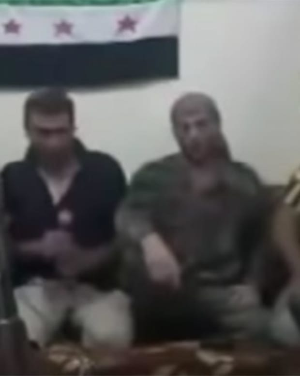 Syrian Rebel Takes Selfie, Forgets About Bomb (Video) Promo Image