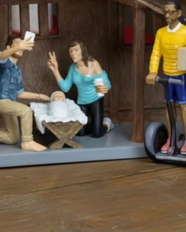 Joseph, Mary, Baby Jesus Take Selfie In Nativity Scene (Photo) Promo Image