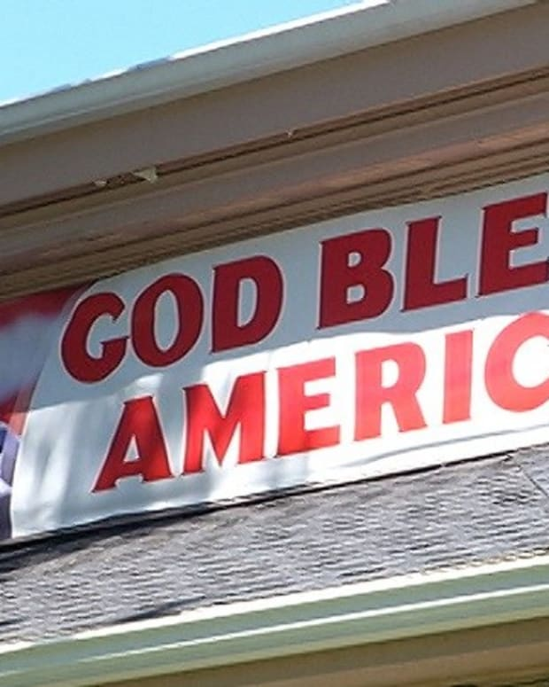 Cafe Owner Asked To Take Down 'God Bless America' Banner Promo Image
