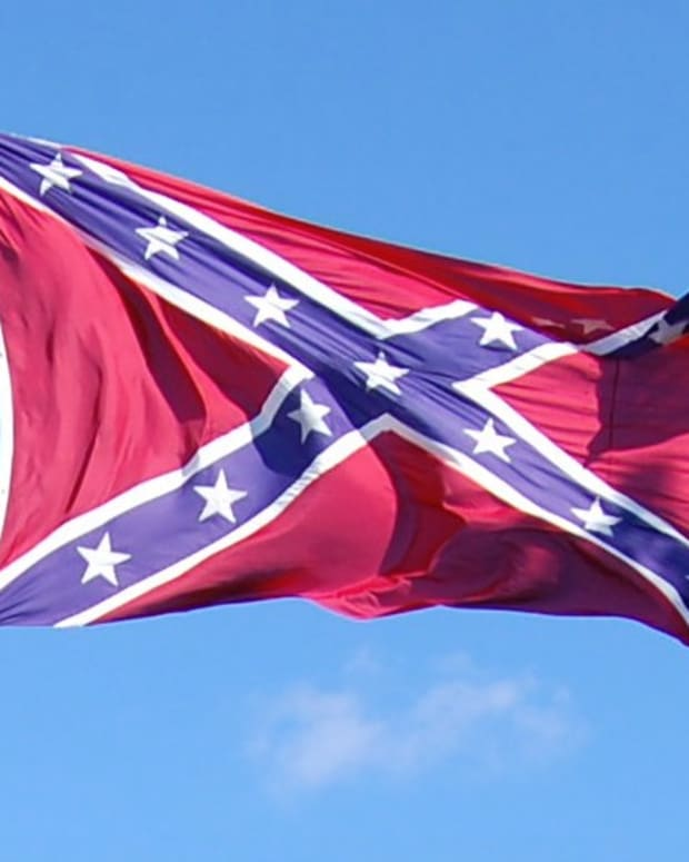 Confederate Flag Flies Near NCAA Tournament Arena Promo Image