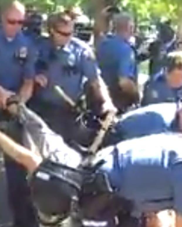 Cops Drag Away Anti-Police Brutality Activist (Video) Promo Image