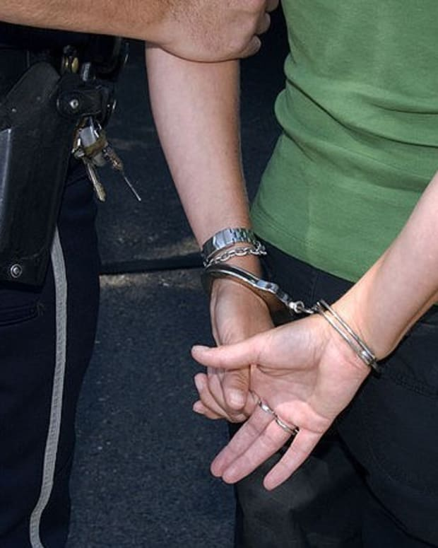 Woman Arrested After Infant Remains Found Under Home (Photos) Promo Image
