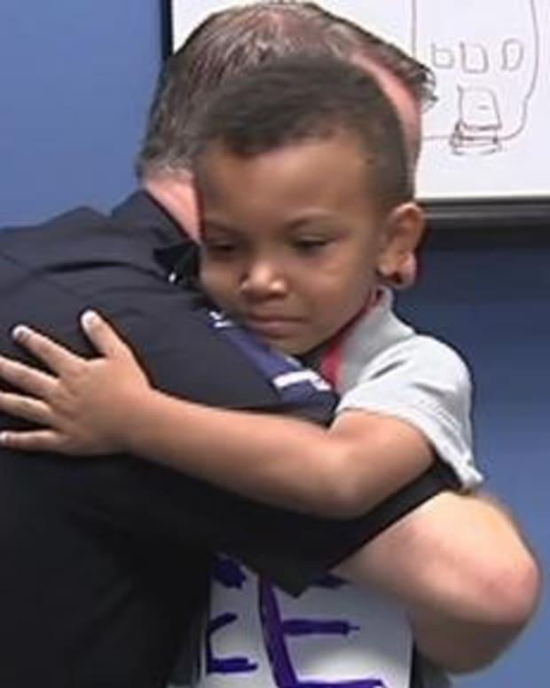 5-Year-Old Boy Gives Police Free Hugs, Doughnuts (Photos) Promo Image