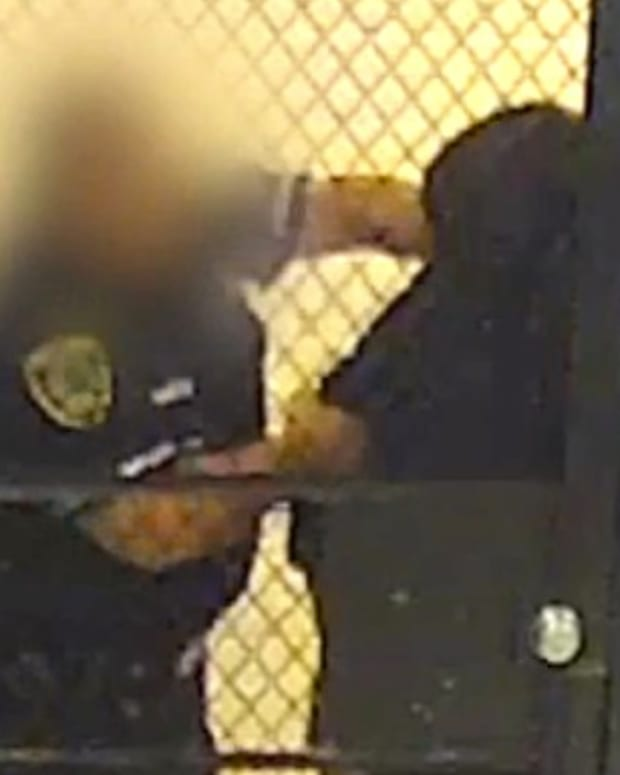 Texas Cop Bashes Handcuffed Man's Head (Video) Promo Image