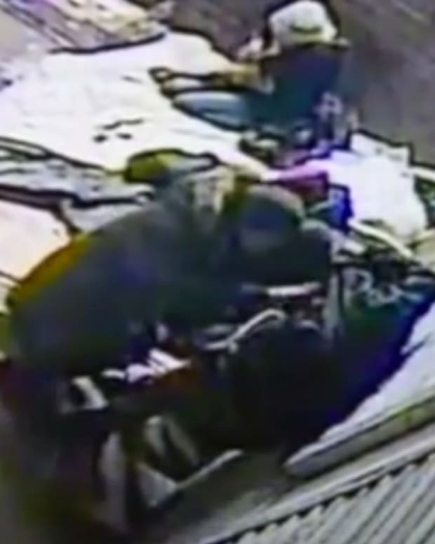 'Thief' Searches Dying Homeless Man's Pockets (Video) Promo Image