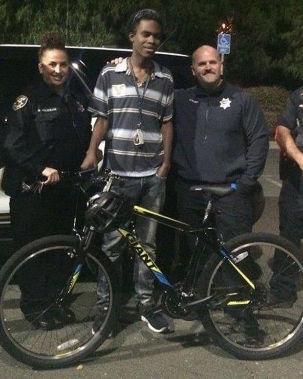 Cop Surprises Carless Teen With Bike Promo Image