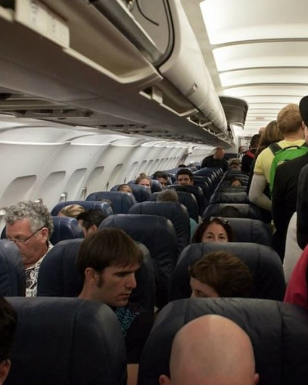 Man On Plane Caught Texting About Child Sex Abuse (Photos) Promo Image