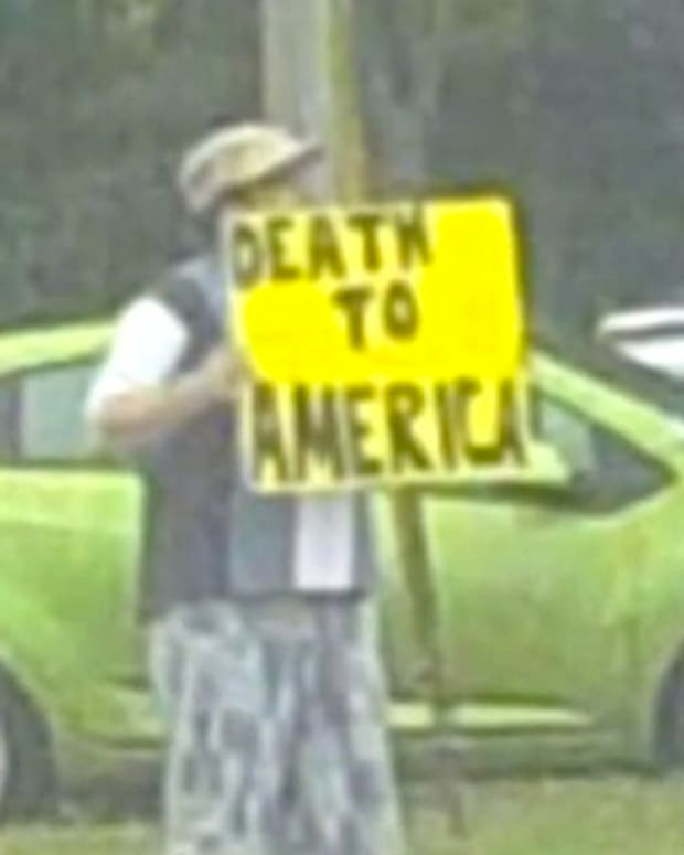 Man Holding 'Death To America' Sign Is Beaten (Video) Promo Image