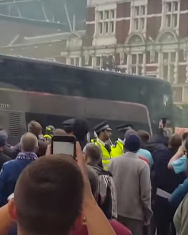 Soccer Fans Attack Opposing Team's Bus (Video) Promo Image