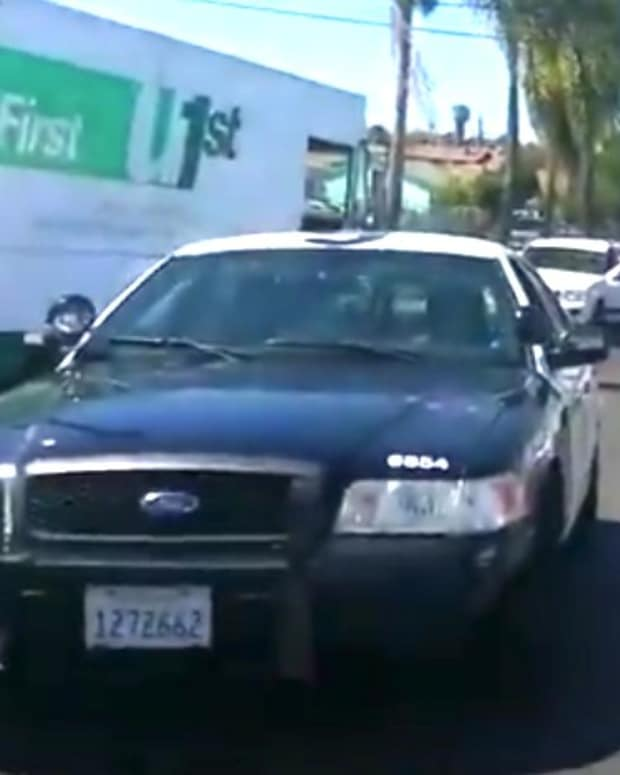Four Cops Arrest Black Man For Stepping Off Curb (Video) Promo Image