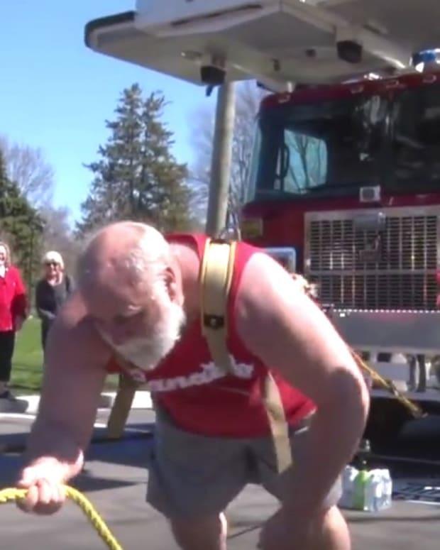 New World Record: Pair Pull Three Fire Trucks (Video) Promo Image