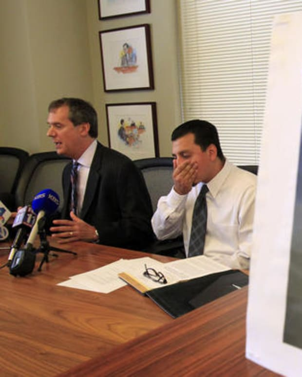 Gabriel Carrillo And His Attorney Ronald Kay And A Picture Of Carrillo's Face.