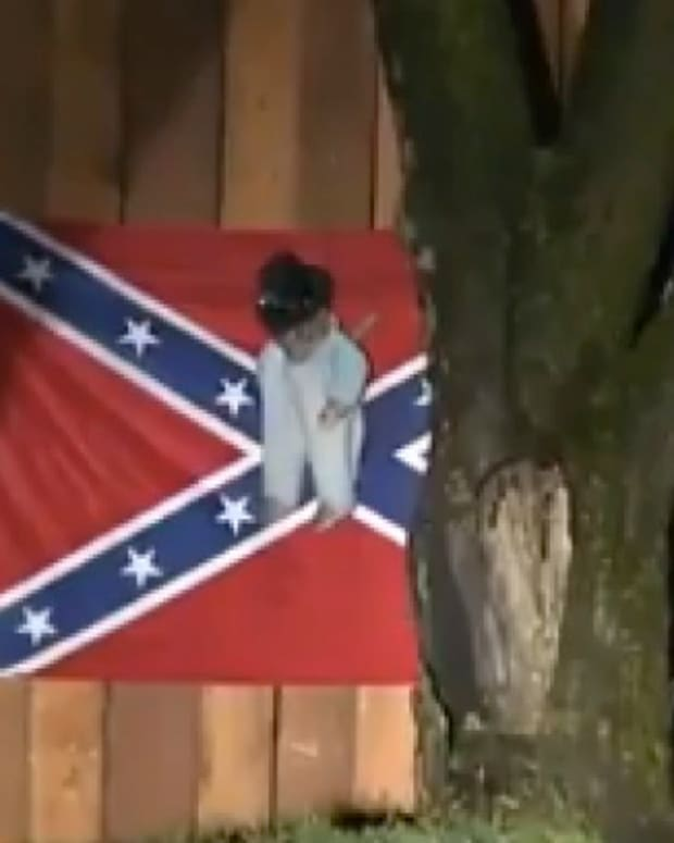 A Confederate Flag With a Doll Hanging from a Noose
