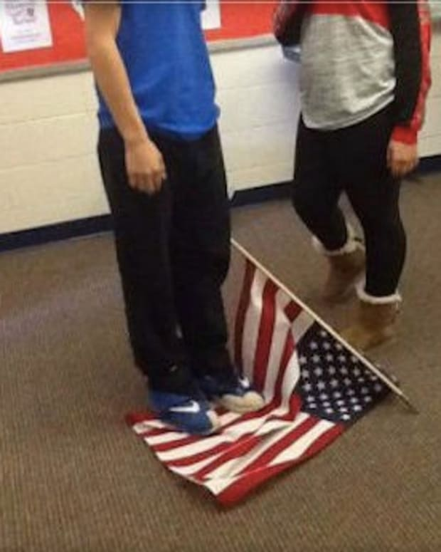 Student Standing On Flag
