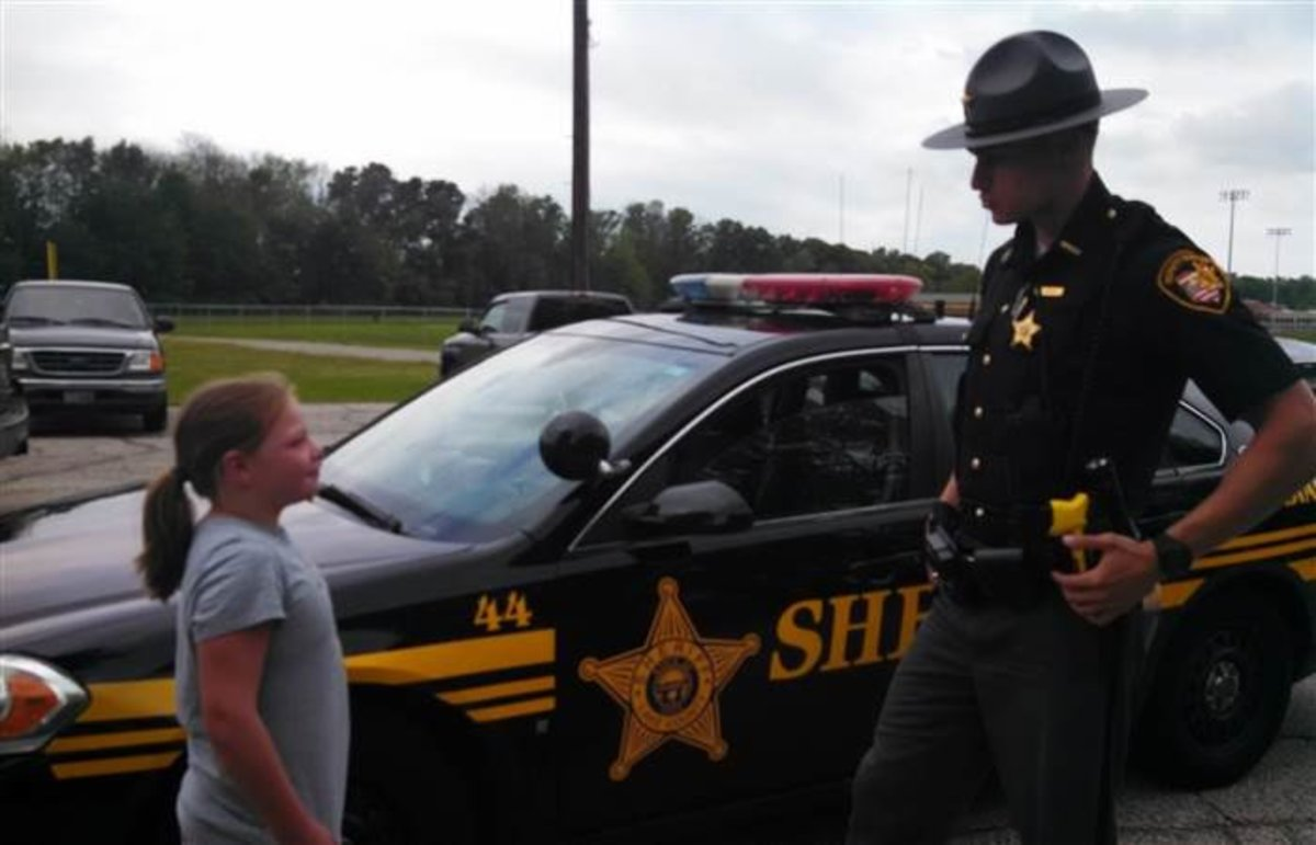 Officer Buys Lemonade From Young Girl's Stand And Comes Back The Next Day -- But Not To Buy More Promo Image