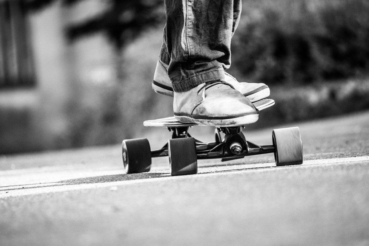 Boy Uses Getaway Skateboard After Gas Station Stick-Up Promo Image