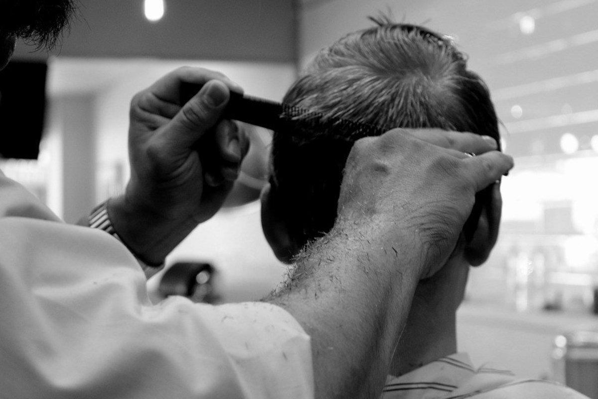 Barber Gives Man 'Three Stooges' Haircut, Snips His Ear (Photos) Promo Image