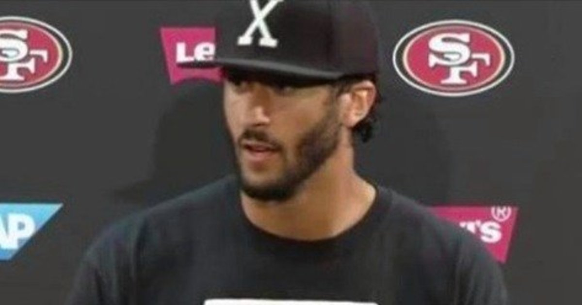 Colin Kaepernick's Shirt At Press Conference Sparks Outrage (Photo) Promo Image