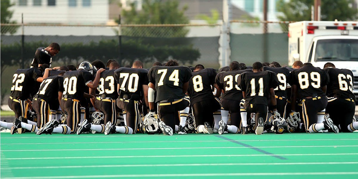 High School Athletes Pray Before Game, Defying New Ban (Photos) Promo Image
