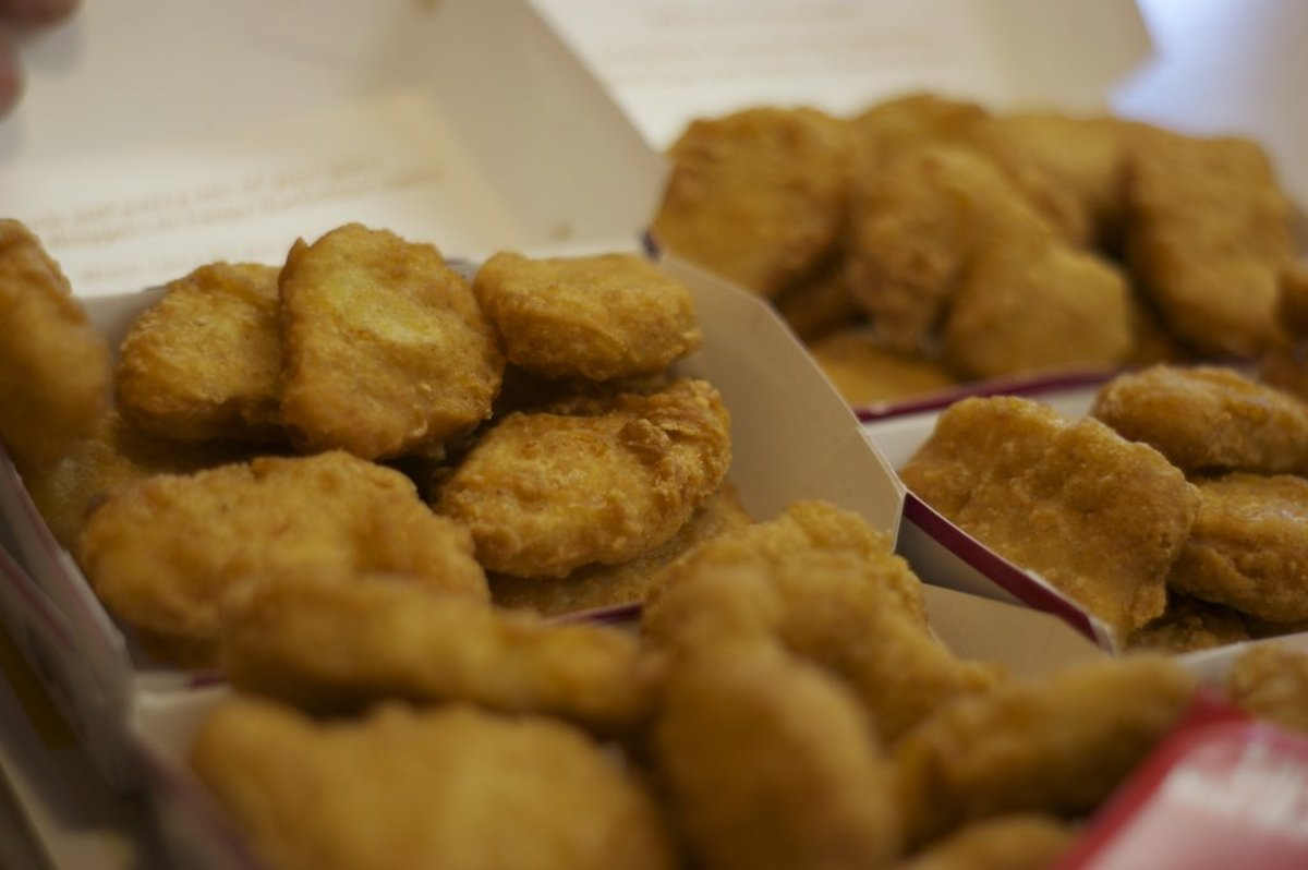 Man Feeds Girlfriend Chicken Nuggets, Image Goes Viral (Photos) Promo Image